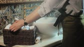 dobras : Woman folds clean soft towels in the basket, cleaning concept Stock Footage