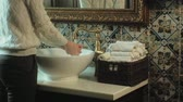 dobrado : Woman washes her hands and dries them, concept of cleanliness Stock Footage