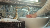 dobras : Woman washes her hands and dries them, concept of cleanliness Stock Footage