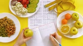 есть : sports calendar, healthy food, shooting on a yellow background top view