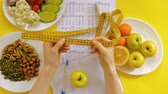 caloria : sports calendar, healthy food, shooting on a yellow background top view