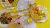 блогов : sports calendar, healthy food, shooting on a yellow background top view