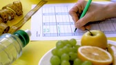 disziplin : Keeping a fitness calendar.concept of healthy food, diet, top view, yellow background