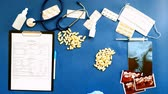 sheets : Doctors desk, top view on blue background, medicine concept Stock Footage