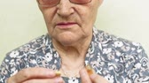 dobras : old woman drinks pills close up face Stock Footage