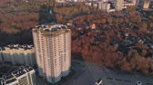 negócio : Cityscape. Residential complex on the river bank. Aerial footage from a copter at sunset time