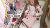 szafa : Beautiful little girl in the home wardrobe. Fashionable children Wideo