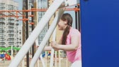 akce : Teenager girl on the open site with exercise equipment. healthy lifestyle Dostupné videozáznamy