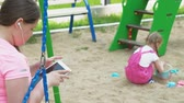 playground : Children use a computer tablet, walk on the playground Stock Footage