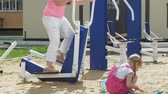 open : Teenager girl on the open site with exercise equipment. healthy lifestyle Stock Footage