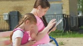 família : teenage girl preschool girl using mobile devices outdoors Stock Footage