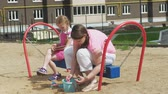 teenagers : Children use a computer tablet, walk on the playground Stock Footage