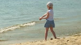 детский сад : Preschool girl walks by the river on a summer day