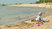 školka : Children playing on the beach by the river on a sunny day