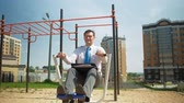 engagé : Businessman on an outdoor sports field. The concept of a healthy lifestyle.