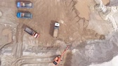 site : Sand quarry. Work excavator and dump truck. Aerial shooting