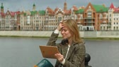 belga : woman uses tablet outdoors. Spring