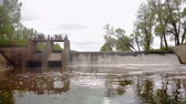 wodospad : Dam on the river. Waterfall. Strong current. Aerial filming Wideo
