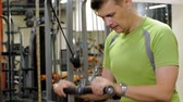 does : Man doing triceps exercises in the gym Stock Footage