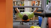 exercises : Man doing bench press in fitness studio Stock Footage