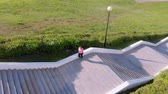 filmagens : A young girl runs up the stairs, sports. Aerial shooting