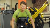 cinto : Man works out at the gym on simulators. Sport .Healthy lifestyle Stock Footage