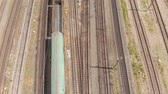 infrastructuur : Railway tracks with freight trains top view. aerial survey Stockvideo