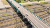 детский : Road bridge passing over the railroad track. aerial survey Стоковые видеозаписи