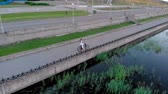 The girl rides a bike. Aerial shooting Stock Footage
