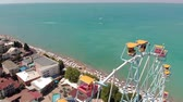 타기 : Ferris wheel on the seashore. Aerial shot