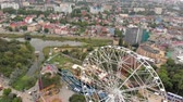 カーニバル : Amusement park by the sea. View of the ferris wheel and the water park with a drone. Shooting from a height