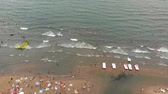 Flight over the city beach at sea. Aerial shot