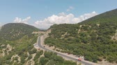szerpentin : Flight over the highway in the mountains. Aerial shot