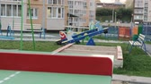 gençler : Teen girl playing table tennis outdoors Stok Video