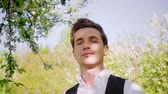 haver : Portrait of a man in a spring forest. Slow motion