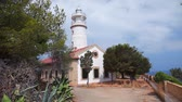 bue : Lighthouse on hill in Port de Soller, Mallorca Island, Balearic Islands, Spain Stock Footage