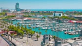 establishing shot : Barcelona aerial view, Port Vell yachts and Barceloneta buildings Stock Footage