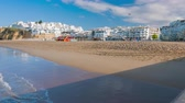 Albufeira town white houses and Atlantic ocean sandy beach