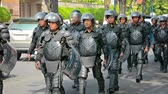 riot control : PHNOM PENH. CAMBODIA - 29 DEC 2013: Cambodian riot police march on a central street Stock Footage