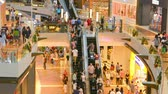 shopping : SINGAPORE - CIRCA DEC 2013: The crowd going on the floors and escalators of shopping complex