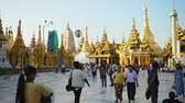 dagon : YANGON. MYANMAR - 03 JAN 2014: Visitors of the famous Shwedagon Zedi Daw
