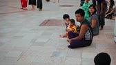 dagon : YANGON. MYANMAR - 03 JAN 2014: Family on the floor. The temple Shwedagon Zedi Daw