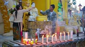 dagon : YANGON. MYANMAR - 03 JAN 2014: Parishioners watered Buddha statues. Traditional ritual of bringing benefit