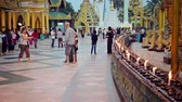 dagon : YANGON. MYANMAR - 03 JAN 2014: Many tourists from all over the world visit Shwedagon Zedi Daw (Great Dagon Pagoda)
