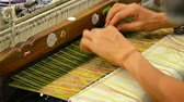 shuttle : BANG PA-IN. THAILAND - CIRCA NOV 2013: Local artisan weaving a beautiful. colorful mat with intricate patterns by hand on a traditional. wooden loom. Stock Footage