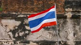 Аюттхая : Video UltraHD 3840x2160 - Thai Flag. with its alternating red. white and blue stripes. flutters cheerfully in the breeze from its wall-mounted pole in Ayutthaya. Thailand.