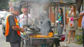 капитализм : AYUTTHAYA. THAILAND - CIRCA FEB 2015: Local street food vendor serving customers on the street outside Ayutthaya Historical Park in Thailand.