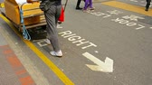 aviso : HONG KONG. CHINA - CIRCA JAN 2015: Caution sign. painted on a busy city street. warns pedestrians to look out for oncoming traffic in downtown Hong Kong.