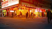 corner : HONG KONG. CHINA - CIRCA JAN 2015: Customers. strolling along a busy shopping district in downtown Hong Kong in the evening. Stock Footage