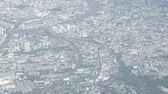 major city : Hazy aerial view of a heavily developed metropolitan area with highways and rivers. Stock Footage